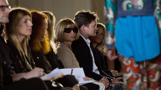 Anna Wintour, wearing sunglasses, looks on as the Thakoon Spring 2012 collection is modeled Sunday, Sept. 11, 2011, during Fashion Week in New York. (AP Photo/Karly Domb Sadof)