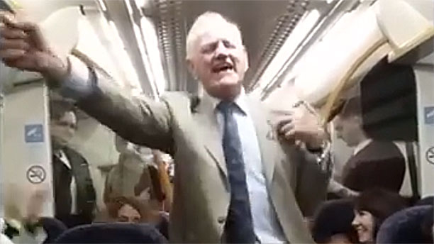 A singing drunken Brit on a train (pic: YouTube)