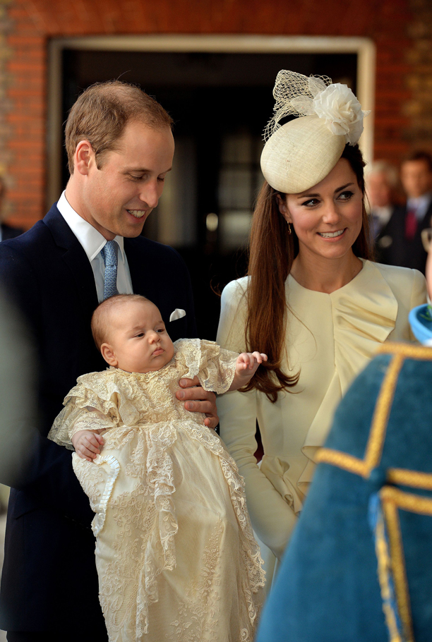 Prince George's first birthday. File photo dated 23/10/13 of The Duke and Duchess of Cambridge with their son Prince George on his Christening day. Prince George first birthday is on July 22. Issue date: Sunday July 13, 2014. See PA story ROYAL George. Photo credit should read: John Stillwell/PA Wire URN:20383116
