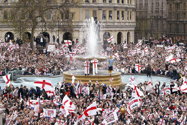 Crowds gather in Trafalgar Square to greet England's victorious Rugby World Cup team who were to finish their open-top bus ride Victory Parade their in London, Monday Dec. 8, 2003. Hundreds of thousands of people gathered to greet the team. (AP Photo/David Davies, POOL)