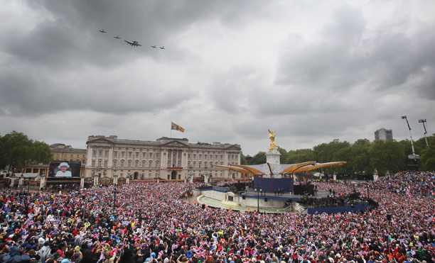 Diamond Jubilee celebrations. Planes fly overhead during a ceremonial flypast as Queen Elizaeth II stands on the balcony of Buckingham Palace, London, during the Diamond Jubilee celebrations. Picture date: Tuesday June 5, 2012. See PA story ROYAL Jubilee. Photo credit should read: Lewis Whyld/PA Wire URN:13731703