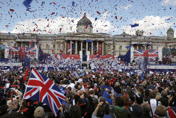 Red, white and blue ticker tape explodes in London's Trafalgar Square, Thursday Oct. 16, as crowds celebrate the success of the British Olympic and Paralympic 2008 team at an official ceremony and parade through the city. The National Galley is in the background.(AP Photo/Kirsty Wigglesworth)