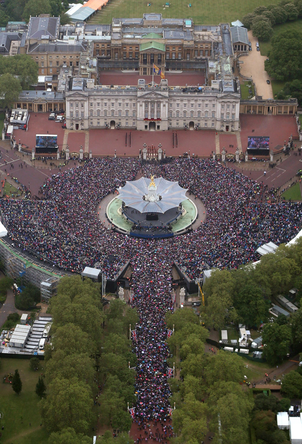 Diamond Jubilee celebrations. Crowds fill The Mall around Buckingham Palace in London ahead of The Diamond Jubilee flypast. Picture date: Tuesday June 5, 2012. See PA story ROYAL Jubilee. Photo credit should read: Peter Macdiarmid/PA Wire URN:13732532