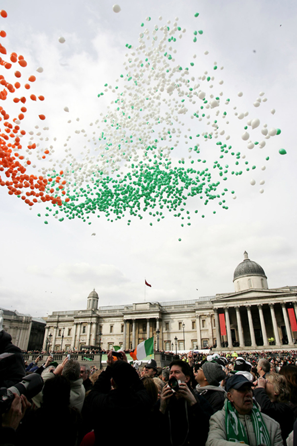 Balloons in the colours of Ireland's tri-colour are released to fly above Trafalgar Square in central London, with the National Portrait Gallery building behind, during a celebration concert given in the square in honour of St Patrick's Day, Sunday, March 12, 2006. (AP Photo/Sang Tan)