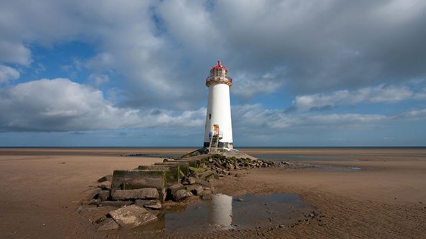Lighthouse on Talacre Beach at low tide with sand dunes North wales (AP)