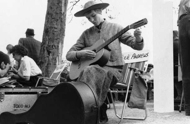 Hot on the heels of Andrews' starmaking debut came The Sound of Music. Here, Julie tunes up her guitar on set in February 1965. (AP)
