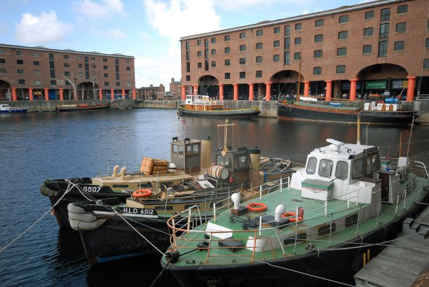 The Albert Dock was originally the center of Liverpool's shipping trade, but is now a vast multi-purpose tourism site including shops and galleries. (Guenter Schenk/PA)
