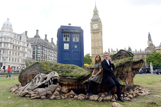 Jenna Coleman, Peter Capaldi and the TARDIS in London's Parliament Square (Pic: Rex Features via AP Images)