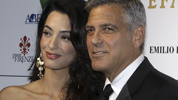 "George Clooney and his fiancee Amal Alamuddin pose for photographers as they arrive for the ""Celebrity Fight Night"" foundation gala dinner, in Florence, Italy, Sunday, Sept. 7, 2014. (AP Photo/Francesco Bellini)"