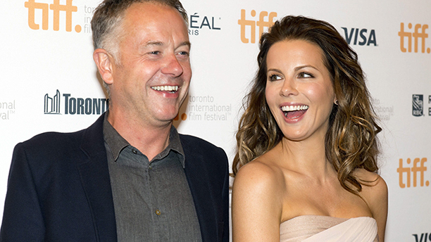 "Kate Beckinsale, right, laughs with director Michael Winterbottom at the premiere for the film ""The Face of an Angel"" at the Toronto International Film Festival in Toronto on Saturday Sept. 6, 2014. (AP Photo/The Canadian Press, Frank Gunn)"
