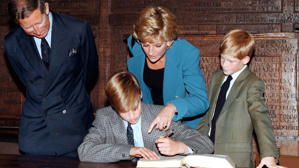 Library filer dated 6/9/95 of Prince William signs the traditional Entrance Book watched by his parents, the Prince and Princess of Wales, and younger brother, Prince Harry, at Eton College. St James's Palace announced today (Wednesday) that Prince Harry has passed the Common Entrance Exam and has been accepted into Eton College in September. PA Photos. Watch for PA story (Press Association via AP Images)