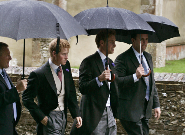 Prince William, 2nd right, and his brother Prince Harry, left, escorted by security personnel, walk to St. Nicholas Church, in Rotherfield Greys near Henley-on-Thames, England, for the wedding of the Duchess of Cornwall's son Tom Parker Bowles to Sara Buys, Saturday Sept. 10, 2005. (AP Photo/Lefteris Pitarakis)