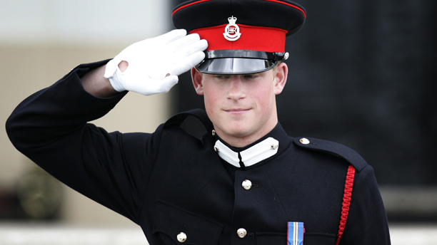 Britain's Prince Harry salutes his father Prince Charles as he leaves, following The Sovereign's Parade at the Royal Military Academy, where Harry received his military commission at Sandhurst, England, Wednesday April 12, 2006. Prince Harry, 21, second son of Prince Charles, began training at the Royal Military Academy last May to become an army officer in the Blues and Royals regiment of the Household Cavalry, one of the British army's oldest units. (AP Photo/Lefteris Pitarakis)