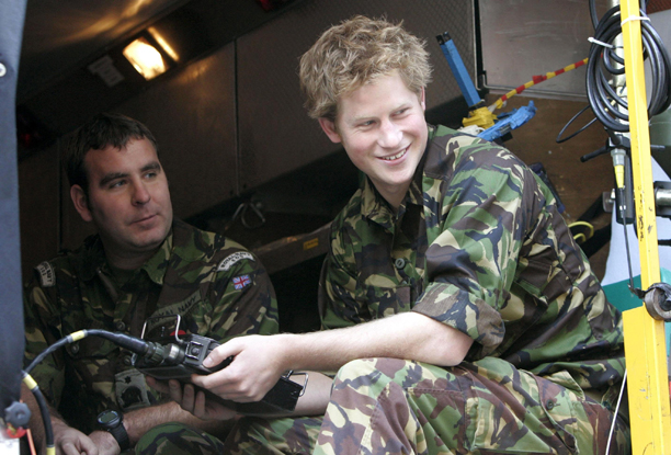 Harry (right) drives a mobile remote Bomb disposal unit during his visit to the Royal Navy's fleet diving squadron at Horsea Island in Portsmouth, where he carried out some underwater engineering. Picture date: Wednesday October 31, 2007. It was Harry's first official visit since becoming Commodore-in-Chief of small ships and diving, a title given following a move by the Queen and First Sea Lord to strengthen links between the Royal Navy and the Royal Family last year. See PA story ROYAL Harry. Photo credit should read: Tim Ockenden/WPA Rota/PA Wire URN:5297075 (Press Association via AP Images)