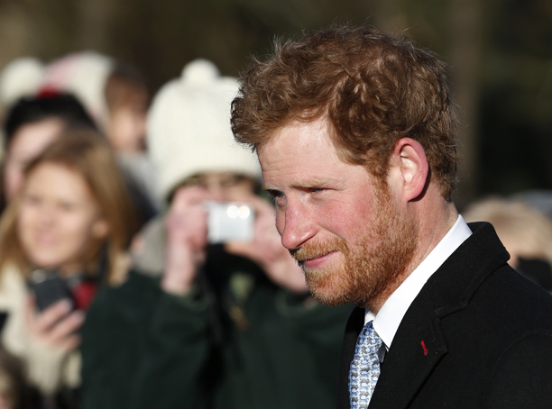 Britain's Prince Harry arrives to attend a Christmas Day Service with other members of the royal family at St. Mary's church on the grounds of Sandringham Estate, the Queen's royal estate in Norfolk, England, Wednesday, Dec. 25, 2013. (AP Photo/Lefteris Pitarakis)