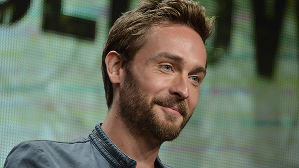"Tom Mison speaks on stage during the ""Sleepy Hollow"" panel at the The FOX 2014 Summer TCA held at the Beverly Hilton Hotel on Sunday, July 20, 2014, in Beverly Hills, Calif. (Photo by Richard Shotwell/Invision/AP)"