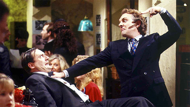 Michael Troughton and Rik Mayall in 'The New Statesman' (Pic: ITV)