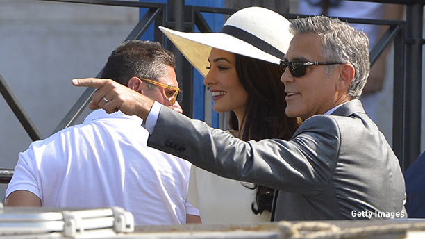 US actor George Clooney and British lawyer Amal Alamuddin leave the palazzo Ca Farsetti on September 29, 2014 in Venice, after a civil ceremony to officialise their wedding.  AFP PHOTO / ANDREAS SOLARO        (Photo credit should read ANDREAS SOLARO/AFP/Getty Images)