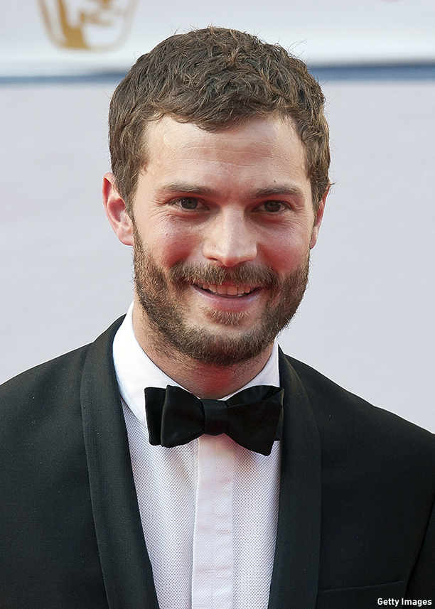 Northern Irish actor Jamie Dornan poses for pictures on the red carpet upon arrival for the BAFTA TV awards in London on May 18, 2014. AFP PHOTO/WILL OLIVER        (Photo credit should read WILL OLIVER/AFP/Getty Images)