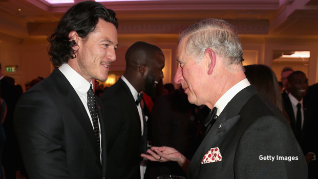 LONDON, ENGLAND - FEBRUARY 06:  Prince Charles, Prince of Wales meets actor Luke Evans at a reception for the Prince's Trust Invest in Futures Gala Dinner at The Savoy Hotel on February 6, 2014 in London, England. The money raised by the event will help disadvantaged young people into jobs.  (Photo by Chris Jackson - WPA Pool/Getty Images)
