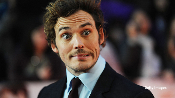 "Sam Claflin is seen playing around at the World Premiere of ""Love, Rosie"" in London, England. (Dave Hogan/Getty Images)"