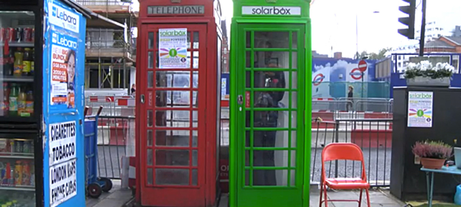 A normal red phone box and a solarbox, London
