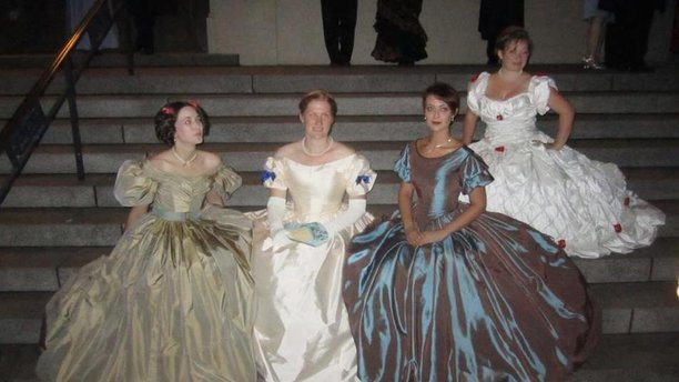 A few Fancily-dressed ladies at the August 2014 Gaskell Ball. (Facebook)