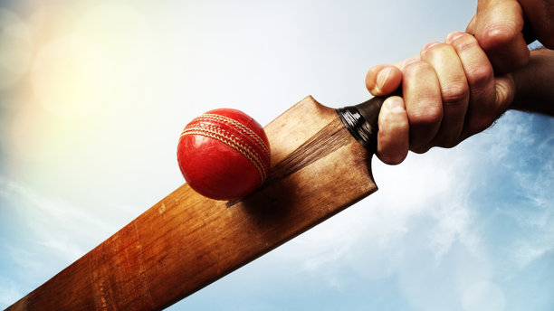A cricket batsman and ball. (AP Images)