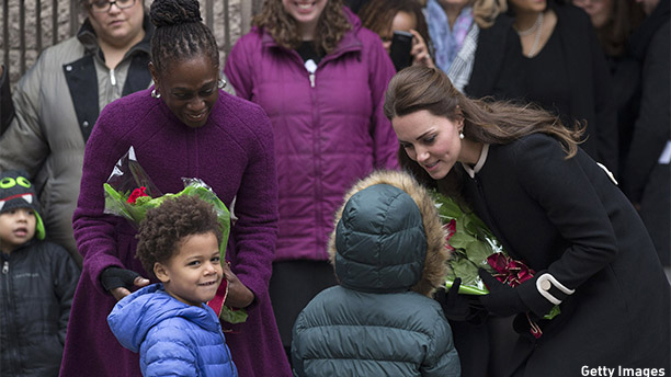 NEW YORK, NY - DECEMBER 08:  Catherine, Duchess of Cambridge (R), talks with children as she leaves with Chirlane McCray, the wife of the current New York mayor, after visiting Northside Center for Child Development on December 8, 2014 in New York City. The royal couple are on an official three-day visit to New York with Prince William also meeting President Barack Obama in Washington D.C on Monday.  (Photo by Carl Court/Getty Images)