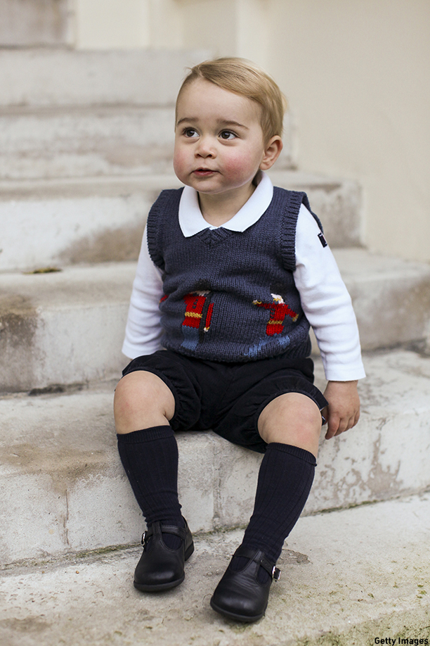 LONDON, ENGLAND - DECEMBER 13:  (Getty Images provides access to this publicly distributed image for editorial use only and is not the copyright owner. No Sales - No Commercial Use) In this handout image of three released on December 13, 2014 by Kensington Palace, Prince George sits for his official Christmas picture in a courtyard at Kensington Palace in late November of 2014 in London, England.  (Photo by The Duke and Duchess of Cambridge/PA Wire via Getty Images)