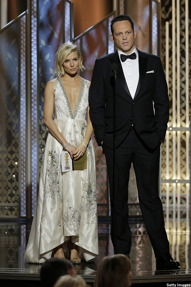 BEVERLY HILLS, CA - JANUARY 11:  In this handout photo provided by NBCUniversal,  Presenters Sienna Miller and Vince Vaughn speak onstage during the 72nd Annual Golden Globe Awards at The Beverly Hilton Hotel on January 11, 2015 in Beverly Hills, California.  (Photo by Paul Drinkwater/NBCUniversal via Getty Images)