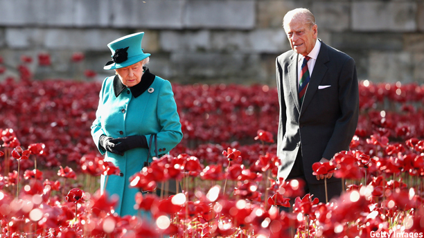 LONDON, ENGLAND - OCTOBER 16:  Queen Elizabeth II and Prince Philip, Duke of Edinburgh visit the Blood Swept Lands and Seas of Red evolving art installation at the Tower of London on October 16, 2014 in London, England. 888,246 poppies will be planted in the moat by volunteers with the last poppy being planted on the 11th November 2014. Each poppy represents a British or Colonial fatality in the First World War. The poppies are for sale with 10% plus all net proceeds going to six service charities.  (Photo by Chris Jackson - WPA Pool /Getty Images)