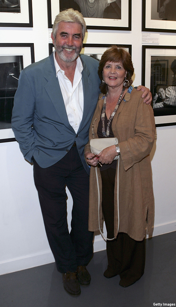 """LONDON - AUGUST 10:  John Alderton and Pauline Collins attend at the private view for """"Off Stage: The RADA Centenary Portraits"""", photographer Cambridge Jones's photographs of 100 Royal Academy Of Dramatic Art-trained stars marking the acting school's centenary, at the Getty Images Gallery on August 10, 2005 in London, England  (Photo by MJ Kim/Getty Images) *** Local Caption *** John Alderton;Pauline Collins"""