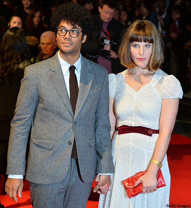 British film writer and director Richard Ayoade and his wife Lydia Fox attend the European premiere of his film 'The Double' during the London Film Festival in central London on October 12, 2013. AFP PHOTO / BEN STANSALL        (Photo credit should read BEN STANSALL/AFP/Getty Images)