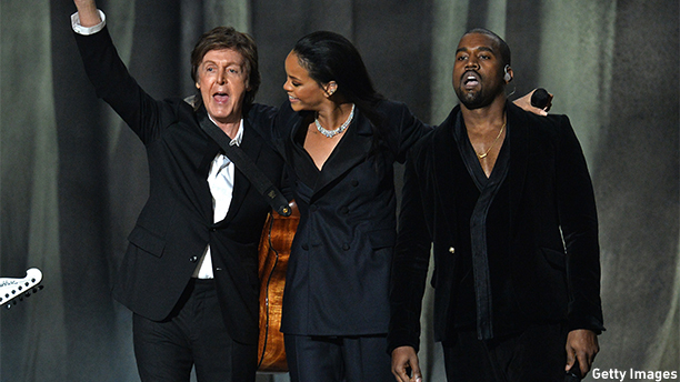 Paul McCartney, Rihanna and Kanye West share the stage at the 57th Annual Grammy Awards in Los Angeles February 8, 2015. AFP PHOTO / ROBYN BECK        (Photo credit should read ROBYN BECK/AFP/Getty Images)