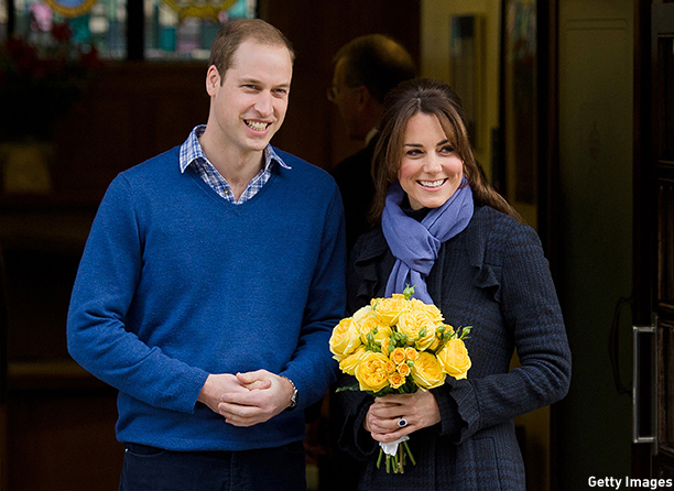 Britain's Prince WiIliam, the Duke of Cambridge, (L) poses for pictures with his wife Catherine, Duchess of Cambridge, as they leave the King Edward VII hospital in central London, on December 6, 2012. Prince William's pregnant wife Catherine left a London hospital on Thursday, four days after she was admitted for treatment for acute morning sickness. AFP PHOTO/Leon Neal        (Photo credit should read LEON NEAL/AFP/Getty Images)
