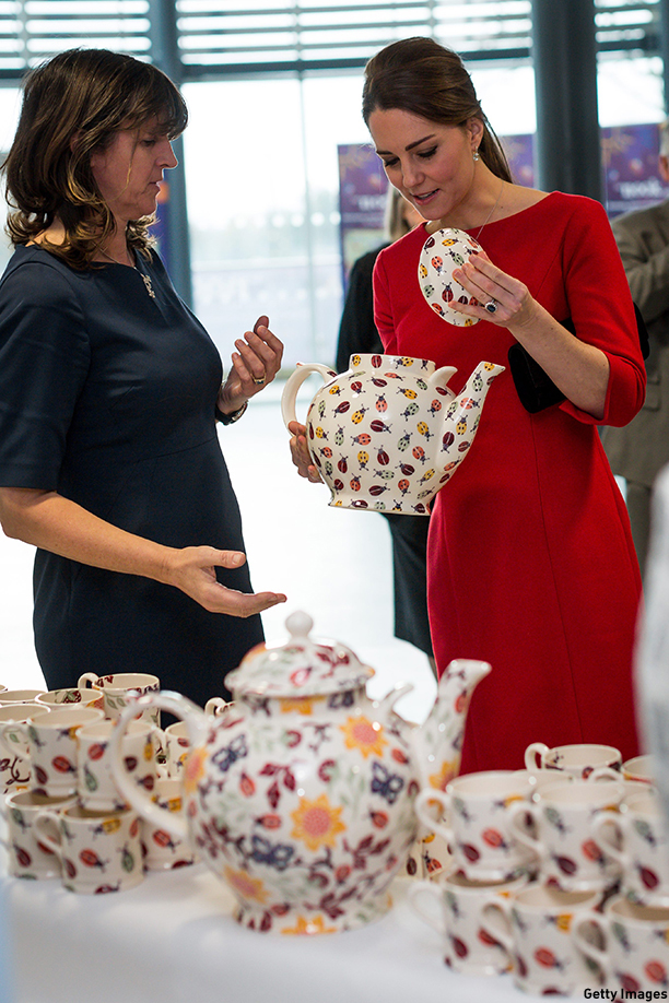 NORWICH, ENGLAND - NOVEMBER 25:  Catherine, Duchess of Cambridge and Emma Bridgewater with her new teapots that will help fundraising as she visits an EACH (East Anglia Children's Hospice) Appeal Launch Event at Norfolk Showground on November 25, 2014 in Norwich, England.  (Photo by Paul Rogers - WPA Pool/Getty Images)