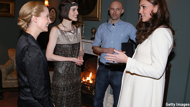 LONDON, ENGLAND - MARCH 12:  Catherine, Duchess of Cambridge chats to actress Michelle Dockery (Lady Mary Crawley) and Joanne Froggatt (Anna Bates)  during an official visit to the set of Downton Abbey at Ealing Studios on March 12, 2015 in London, England.  (Photo by Chris Jackson - WPA Pool/Getty Images)