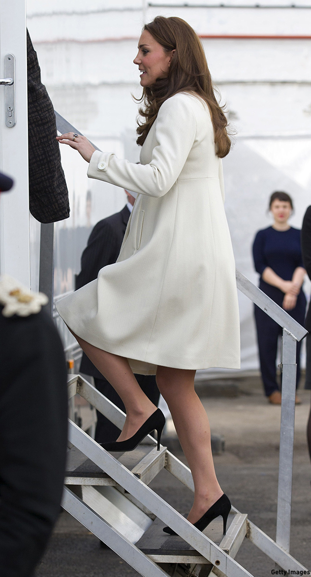 Britain's Catherine, Duchess of Cambridge walks up the stairs into a costume trailer on the set of British television series Downton Abbey at Ealing Studios in west London on March 12, 2015. AFP PHOTO / JUSTIN TALLIS        (Photo credit should read JUSTIN TALLIS/AFP/Getty Images)