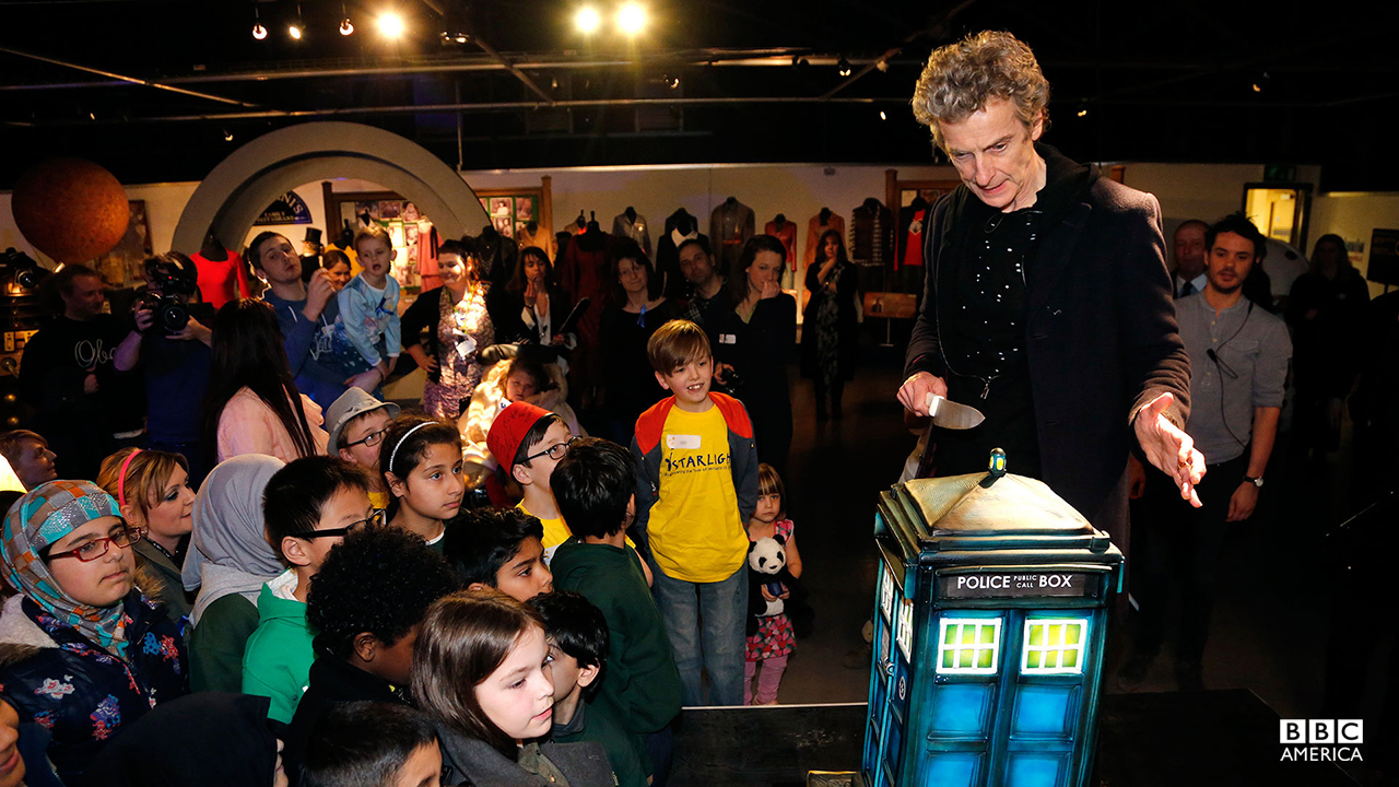 Peter Capaldi took time out of filming Season 9 to celebrate 10 Years of New Doctor Who with fans at the Doctor Who Experience, Cardiff. He led the audience from Starlight and Ty Hafan charities, and a local primary school, in a rendition of Happy Birthday and cut a TARDIS-shaped cake.