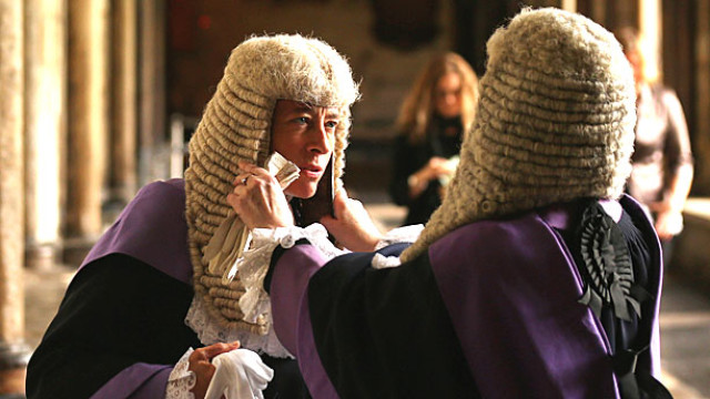 Two judges getting their wigs right before the Annual Service of Thanksgiving at Westminster Abbey, which starts the legal year. (Pic: Oli Scarff/Getty Images)