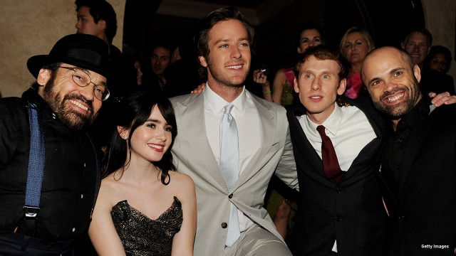 2012: Danny Woodburn, Lily Collins, Armie Hammer, Robert Emms and Sebastian Saraceno in a group shot at the 'Mirror Mirror' after party in Hollywood, California.