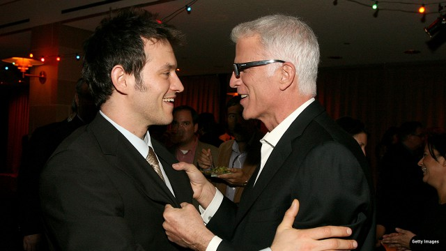 Adam Rothenberg and Ted Danson hug it out at the 'Mad Money' premiere in Westwood, California.