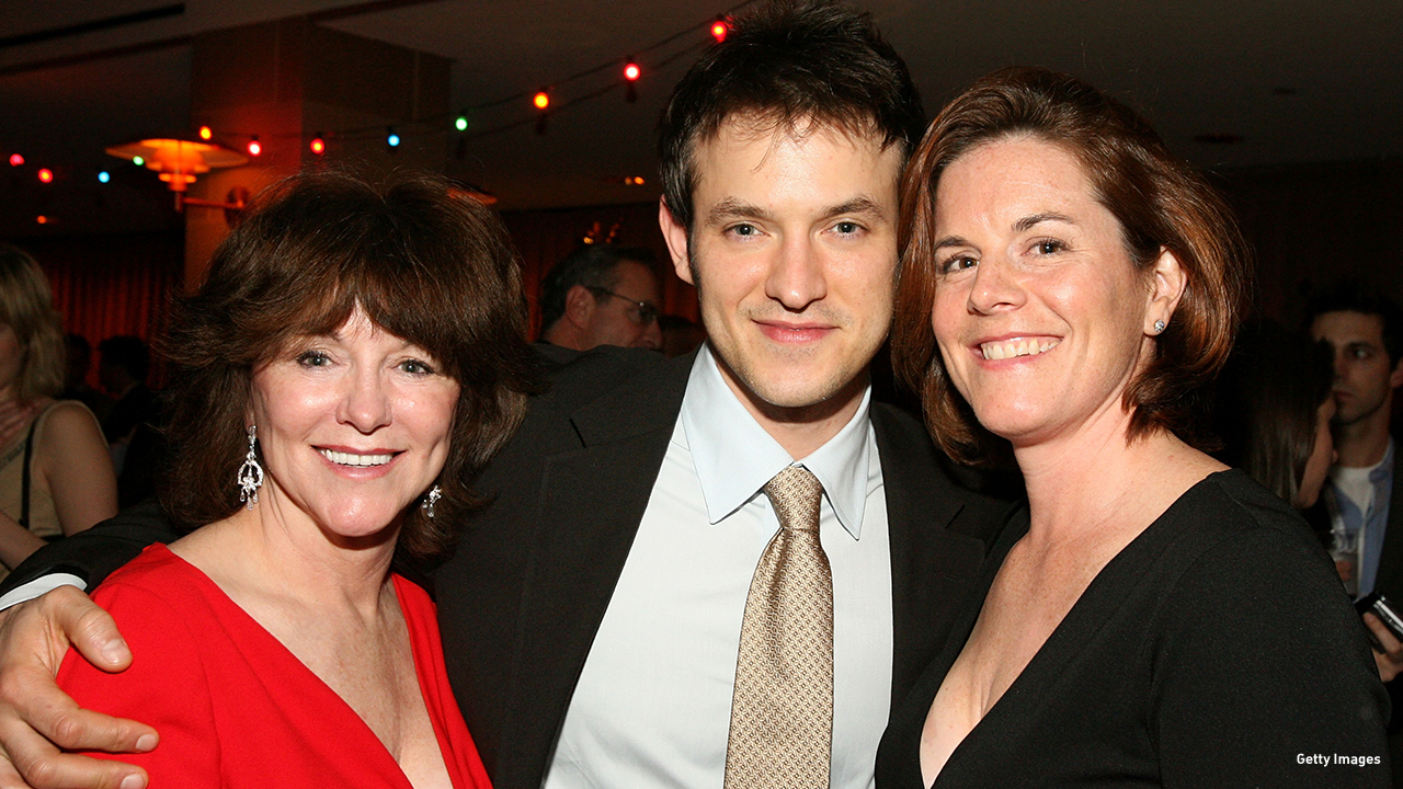2008: Adam Rothenberg keeps his mother (Gillian Rothenberg) and sister (Fiona Rothenberg) close at the 'Mad Money' premiere after party.