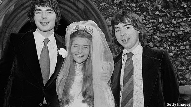 English composer and impresario of musical theatre, Andrew Lloyd Webber (left) accompanies his brother, solo cellist and conductor, Julian Lloyd Webber, on his marriage to journalist, Celia Ballantyne, 1974.  (Photo by Sapiano/Daily Express/Hulton Archive/Getty Images)