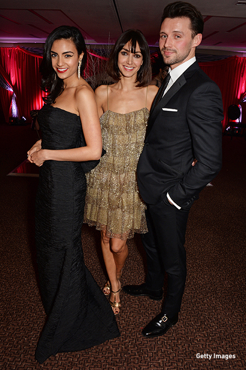2014: Aiysha Hart poses with Chantal Brown and Oliver Walker at 'The Odd Ball' in London.
