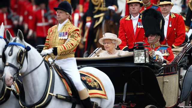 Queen Elizabeth II and Prince Philip, Duke of Edinburgh, arrive to the Trooping the Colour ceremony. (Chris Jackson/Getty Images)