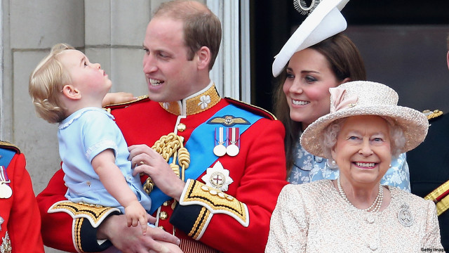 Prince George admires the planes above. (Chris Jackson/Getty Images)