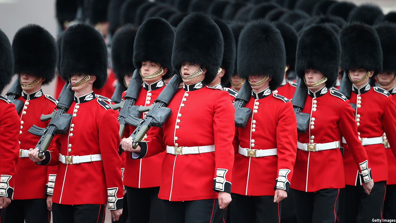 Soldiers march past Buckingham Palace ahead of the Trooping the Colour ceremony. (Chris Jackson/Getty Images)
