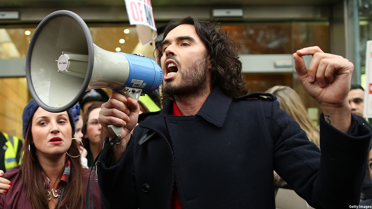 Russell Brand protests pending eviction with residents and supporters from the New Era housing estate in East London in 2014. (Dan Kitwood/Getty Images)